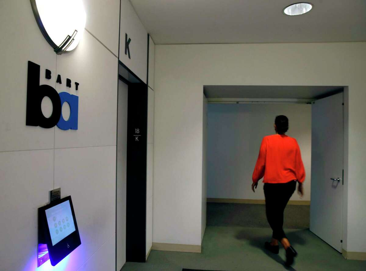 An employee walks into BART's administrative offices at the Kaiser Center in Oakland in 2019. BART office employees who'd mostly been working remotely returned to the transit agency's headquarters in July under a hybrid work schedule.
