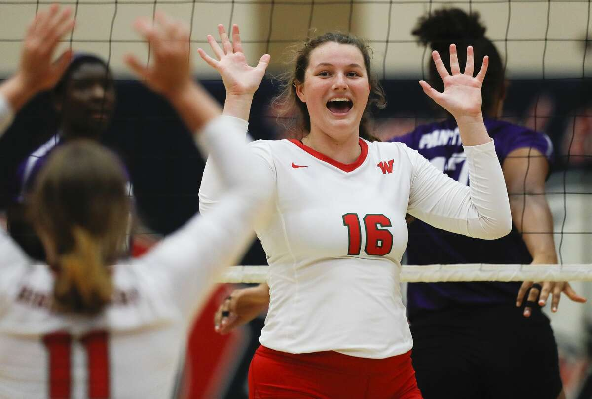 The Woodlands middle blocker Marjorie Johnson (16) reacts after a block during the championship match of the John Turner Classic against Fort Bend Ridge Point at Pearland Dawson High School, Saturday, Aug. 14, 2021, in Pearland.