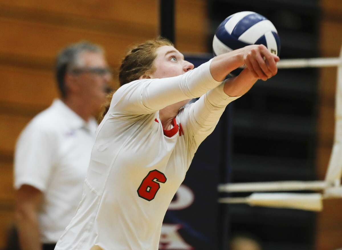 The Woodlands outside hitter Reagan Whatley (6) returns a hit during the championship match of the John Turner Classic against Fort Bend Ridge Point at Pearland Dawson High School, Saturday, Aug. 14, 2021, in Pearland.