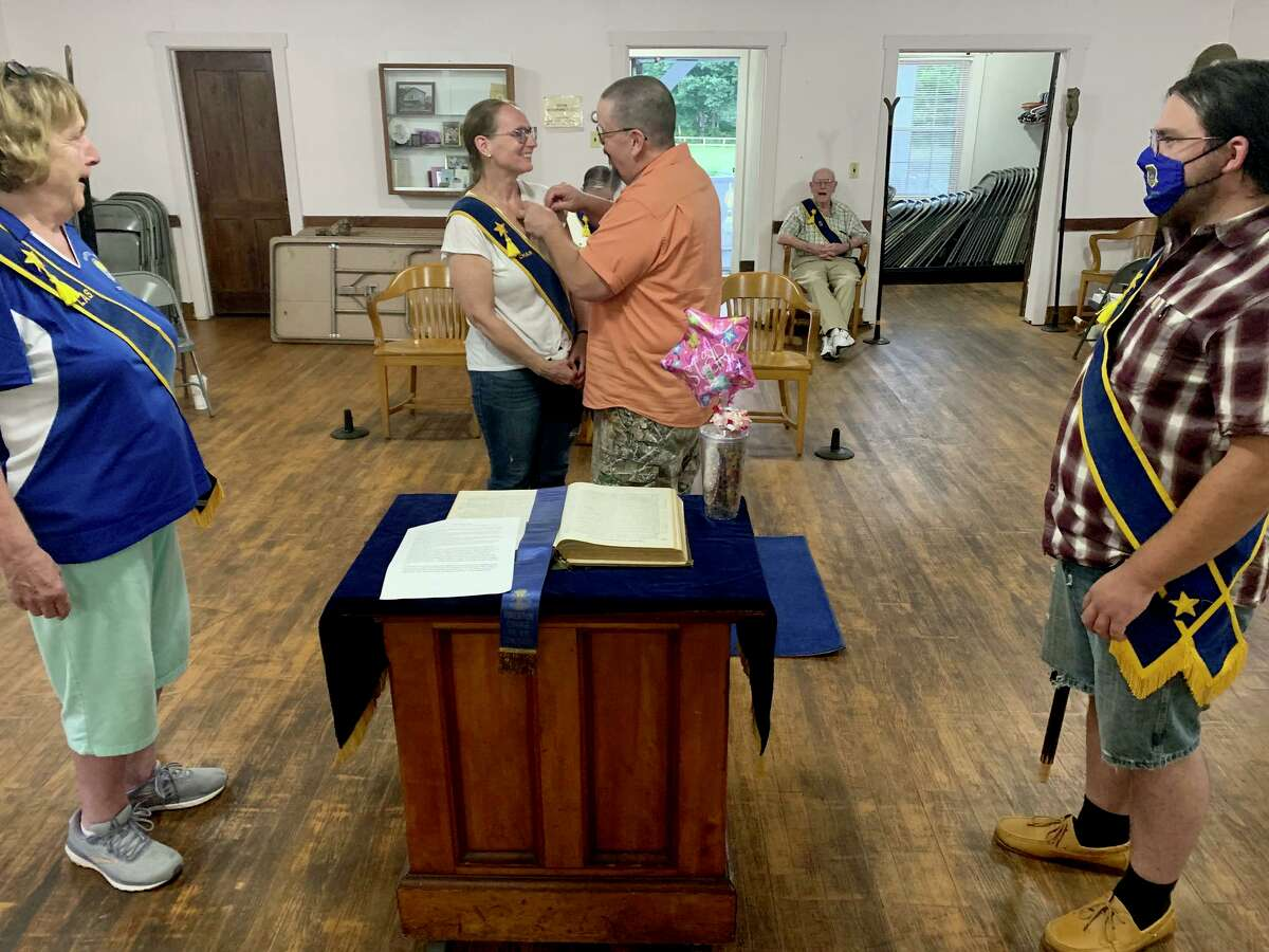 Riverton Grange #169 member Tami Weeks was recently honored as a frontline hero for her service during the coronavirus pandemic, going above, and beyond in serving her special needs students. Shown with Weeks during her recent recognition ceremony are: Weeks' fellow Riverton Grange members Jackie Martin, Roderick Anstett and Shawn Weeks pinning his wife, Tami, with her award.