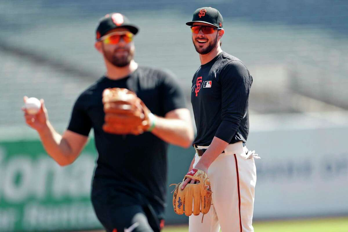 San Francisco Giants' Kris Bryant and Evan Longoria before Bryant's first game as a Giant at Oracle Park in San Francisco, Calif., on Sunday, August 1, 2021.