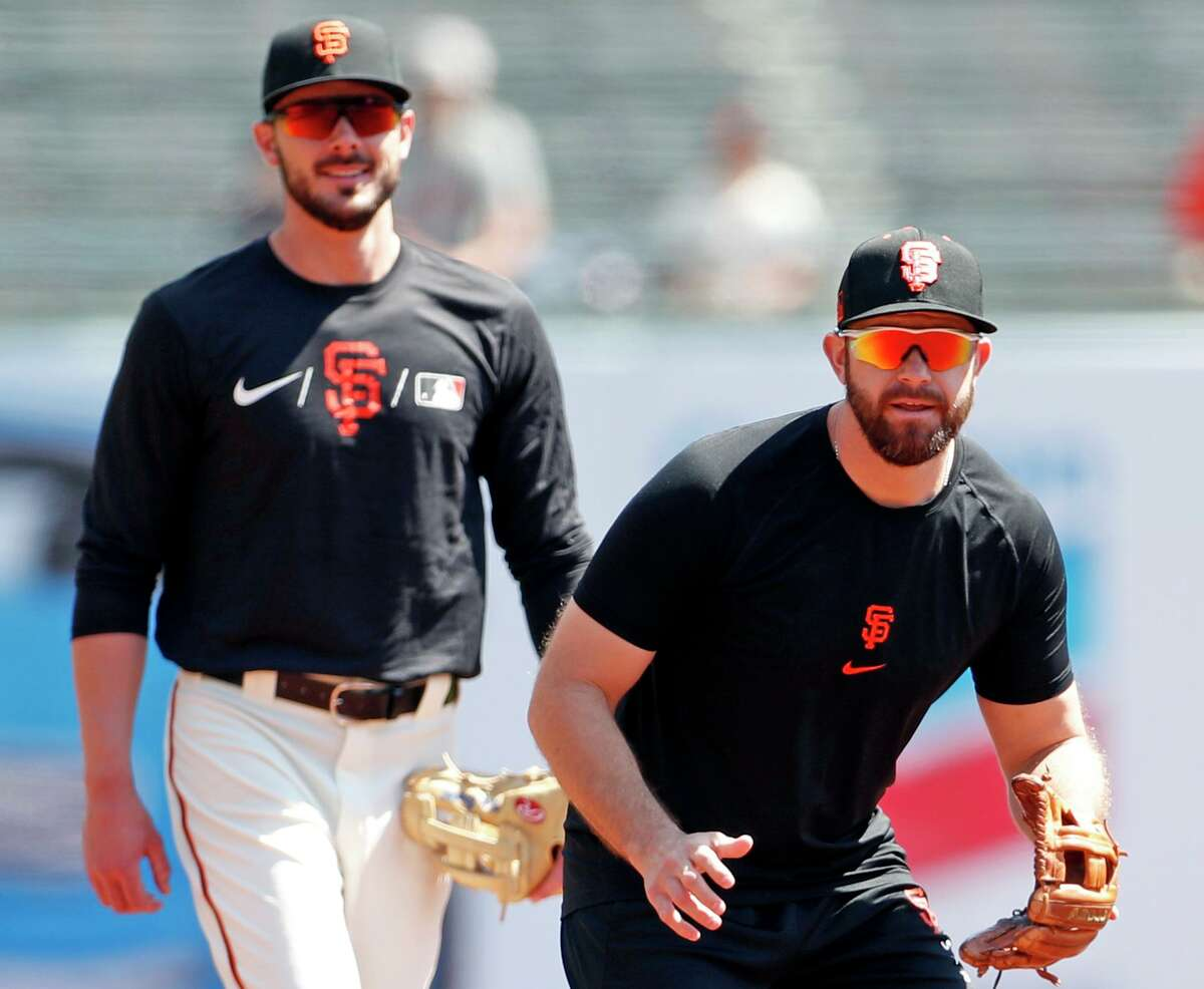 San Francisco Giants' Evan Longoria and Kris Bryant before Bryant's first game as a Giant at Oracle Park in San Francisco, Calif., on Sunday, August 1, 2021.
