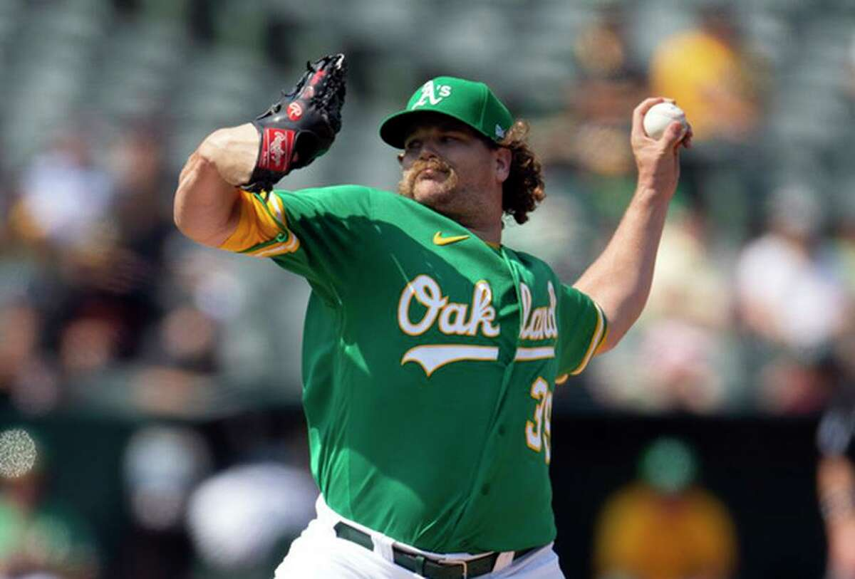 """Athletics pitcher Andrew Chafin has altered his focus this season. """"I want three quick groundball outs."""""""