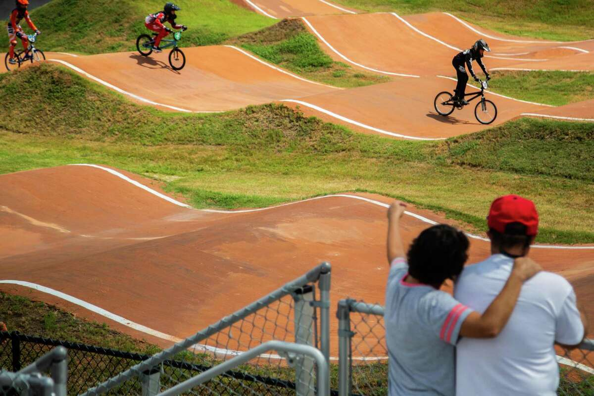 Spectators watch a BMX bike competition as part of Race for Life fundraising event at the Rockstar Energy Bike Park, Saturday, Aug. 14, 2021, in Greenspoint.