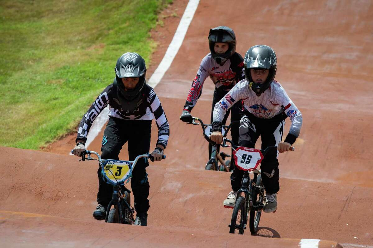 Competitors race at a BMX bike competition as part of Race for Life fundraising event at the Rockstar Energy Bike Park, Saturday, Aug. 14, 2021, in Greenspoint.