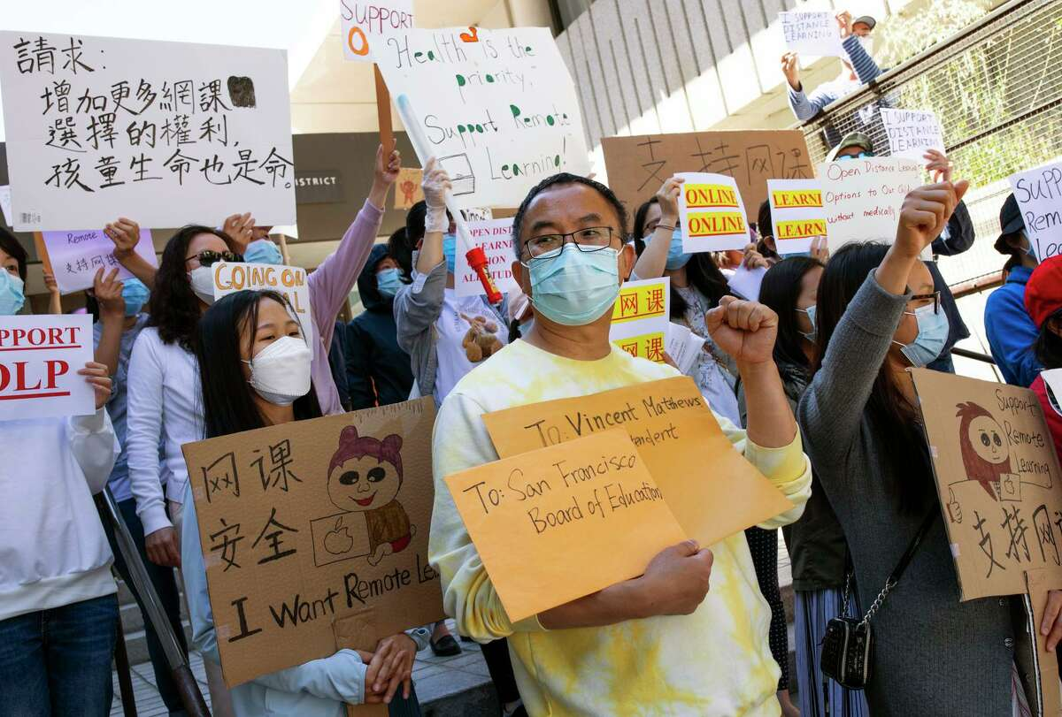 Junjie Lin, a parent of three kids, protests the S.F. Unified School District's return to in-person learning.