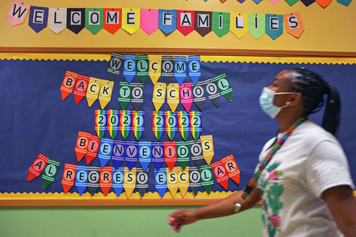 Devina Owens, a first-grade teacher at John Muir Elementary in San Francisco, prepares for Monday's reopening.