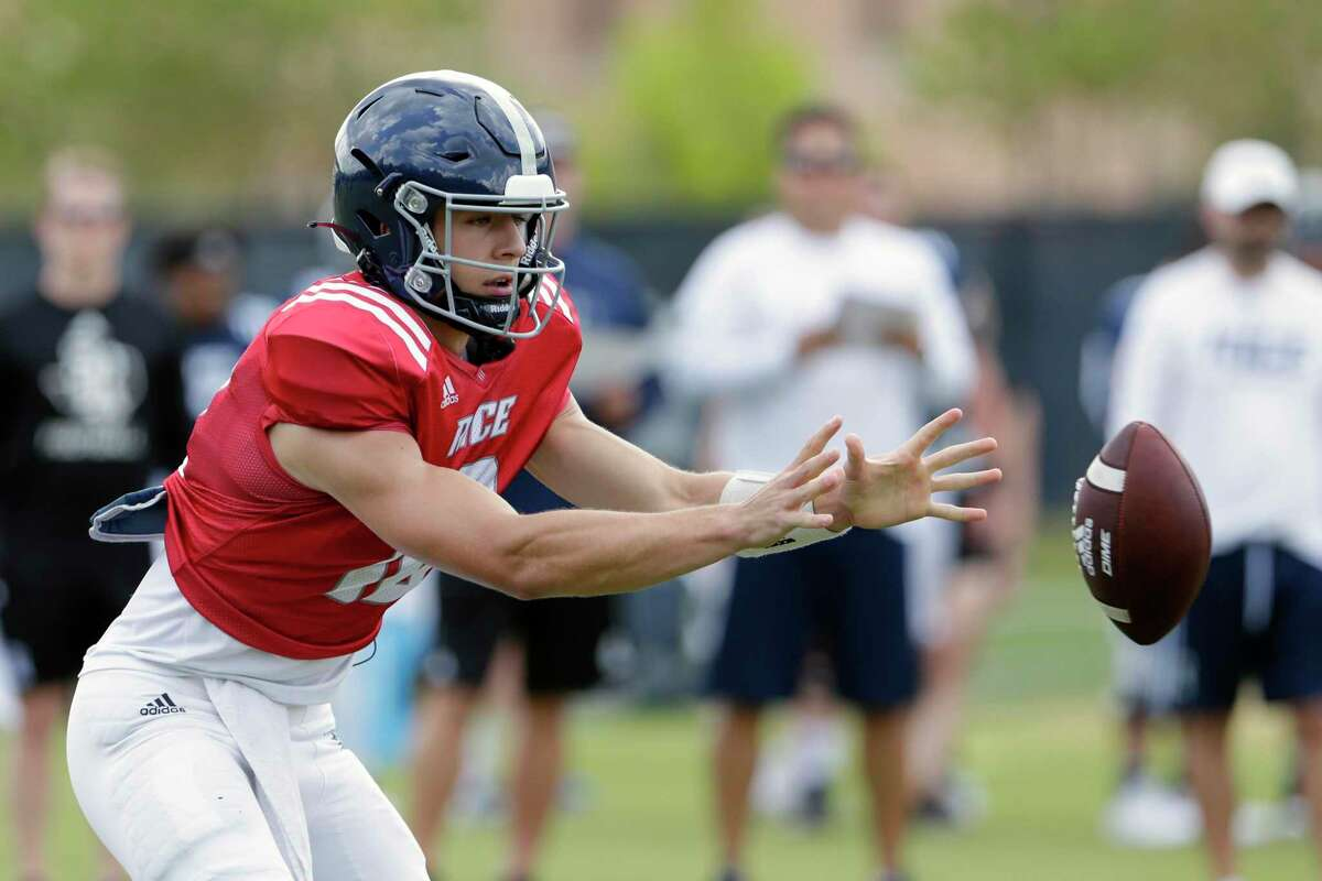 Quarterback Luke McCaffrey takes a snap during a Rice football scrimmage on the practice field Saturday, Aug. 14, 2021 in Houston, TX.