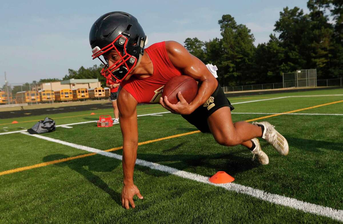 Running back John Milo runs a drill during football practice at Caney Creek High School, Tuesday, Aug. 3, 2021, in Conroe.