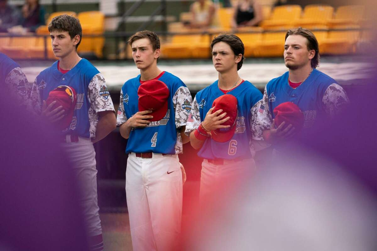 Berryhill's (from left) Lane Kloha, Brody Krzysiak, Nolan Sanders, and Braylen Laverty stand for the national anthem prior to Saturday's American Legion Baseball World Series pool play game against Beverly, Mass. in Shelby, N.C., Aug. 14, 2021.
