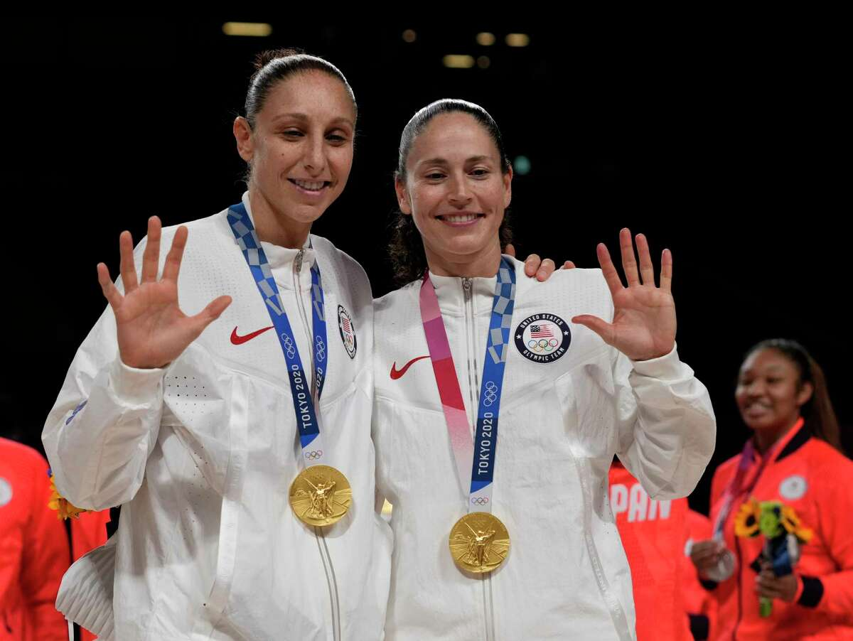 Team United States guard Diana Taurasi (12) and Team United States guard Sue Bird (6) celebrate their fifth Gold medals after winning the Tokyo 2020 Olympic Games Women's Basketball Gold Medal game between United States of America and Japan at Saitama Super Arena on Sunday, August 8, 2021. MUST CREDIT: Washington Post Photo by Toni L. Sandys