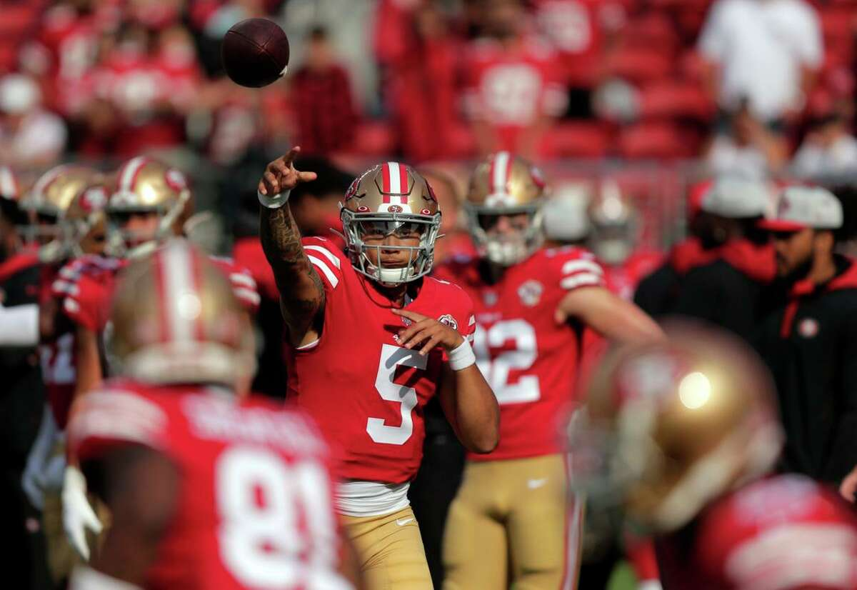 Rookie quarterback Trey Lance (5) throws during pregame warmups before the 49ers played the Kansas City Chiefs at Levi's Stadium in Santa Clara on Saturday, Aug. 14, 2021.