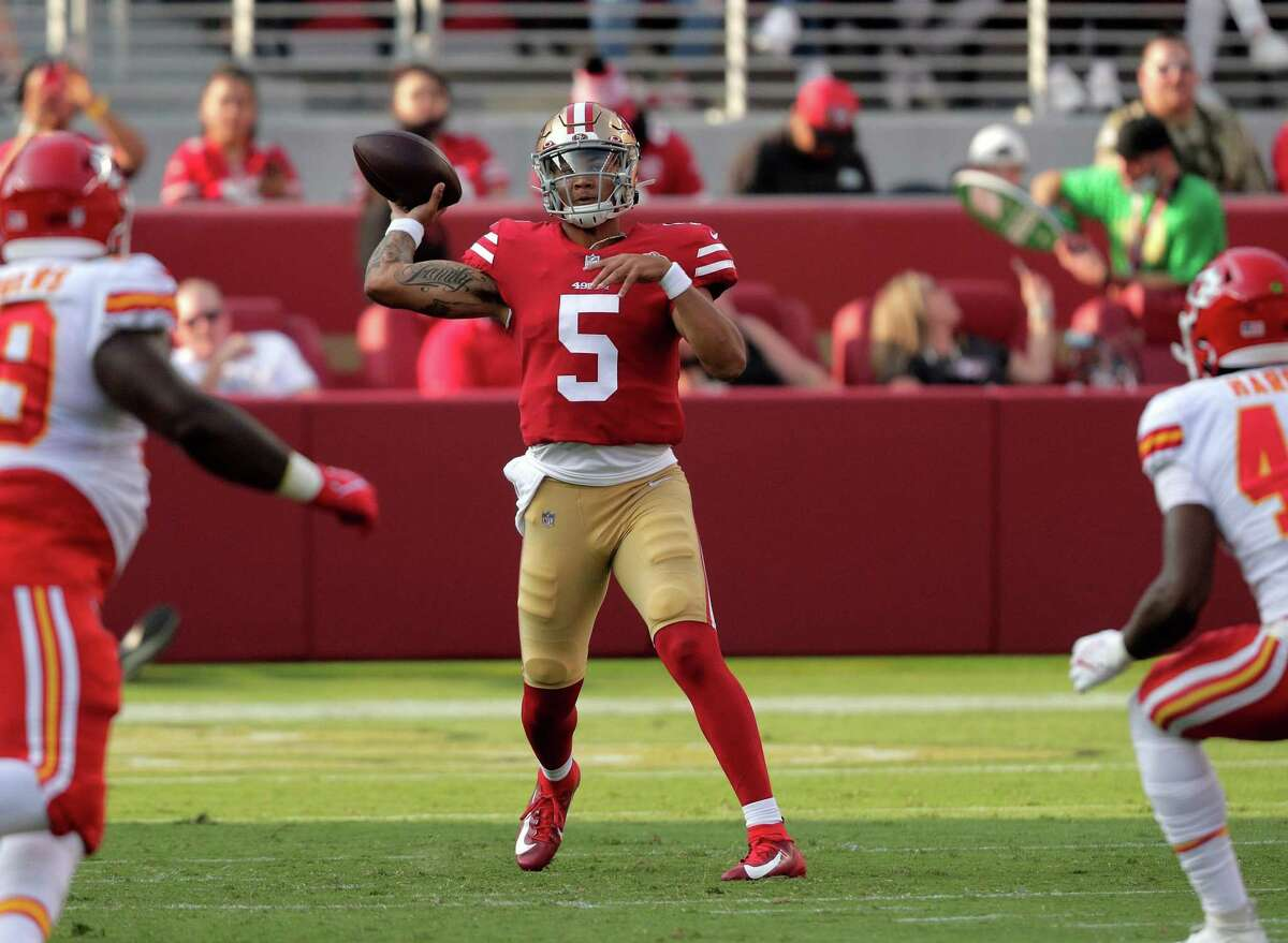 Trey Lance (5) throws a touchdown pass to Trent Sherfield (81) in the first half as the San Francisco 49ers played the Kansas City Chiefs at Levi's Stadium in Santa Clara, Calif., on Saturday, August 14, 2021.