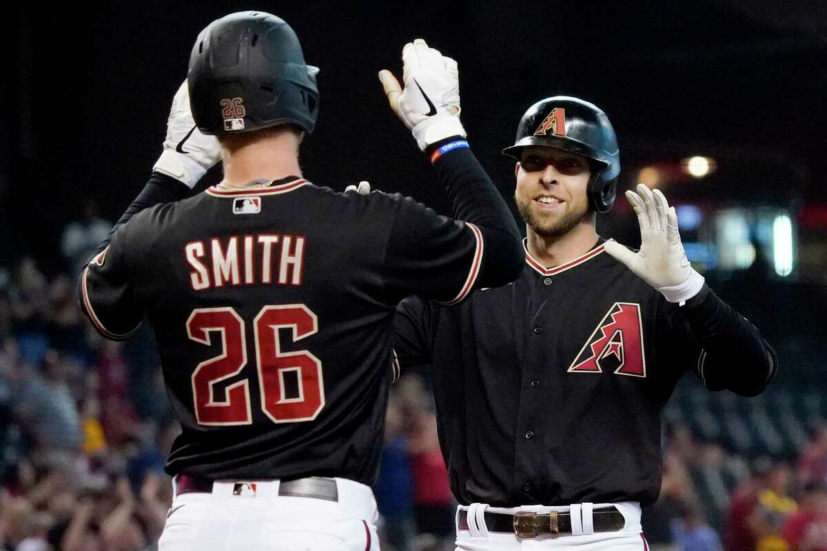 Arizona Diamondbacks' Drew Ellis, right, celebrates his three run home run against the San Diego Padres with teammate Pavin Smith (26) during the first inning of a baseball game, Saturday, Aug. 14, 2021, in Phoenix.