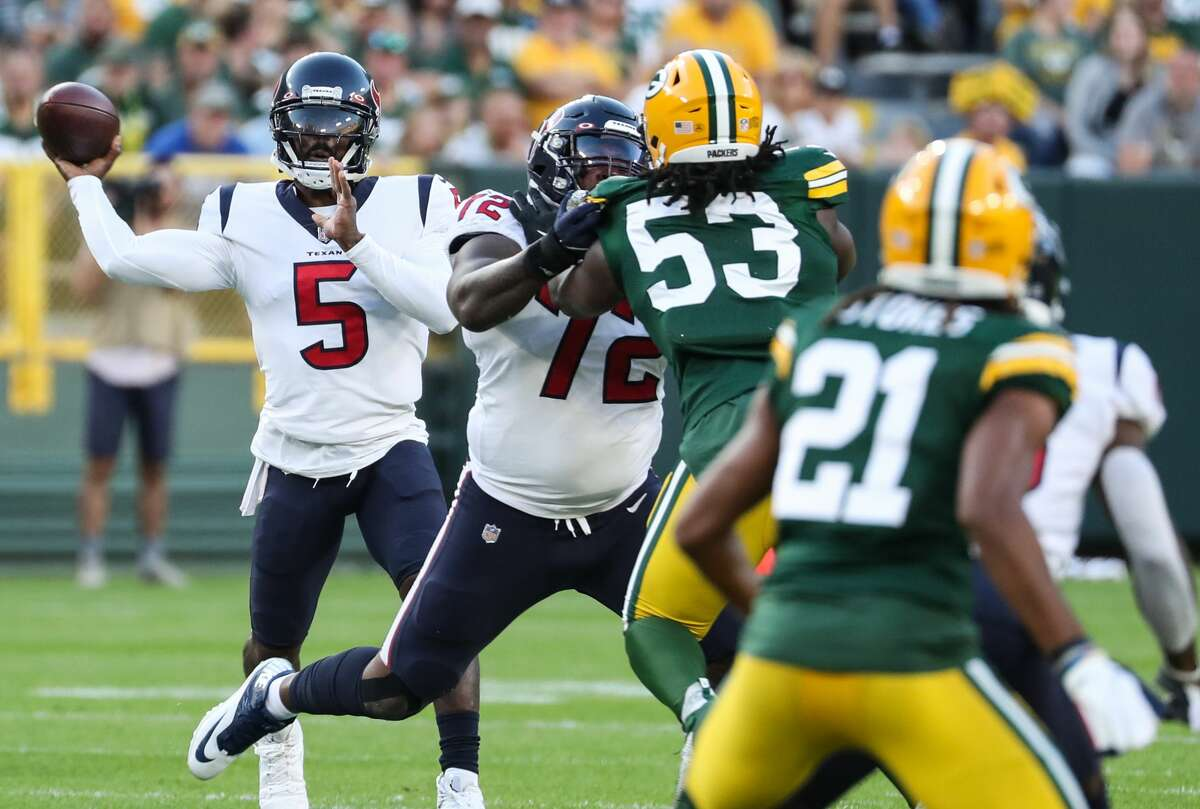 Houston Texans quarterback Tyrod Taylor (5) passes against the Green Bay Packers during the first quarter of an NFL pre-season football game Saturday, Aug. 14, 2021, in Green Bay, Wis.