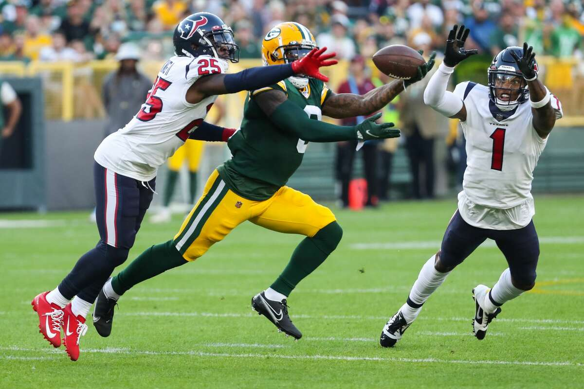 Houston Texans defensive back Desmond King II (25) and cornerback Lonnie Johnson (1) break up a pass intended for Green Bay Packers wide receiver Amari Rodgers (8) during the first quarter of an NFL pre-season football game Saturday, Aug. 14, 2021, in Green Bay, Wis.