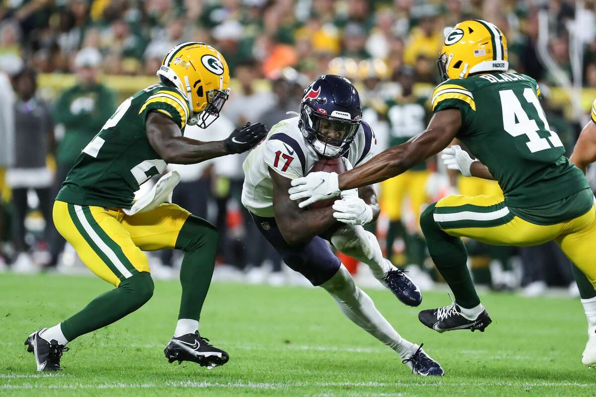 Houston Texans wide receiver Anthony Miller (17) cuts upfield agains Green Bay Packers cornerback Shemar Jean-Charles (22) and safety Henry Black (41) during the second quarter of an NFL pre-season football game Saturday, Aug. 14, 2021, in Green Bay, Wis.