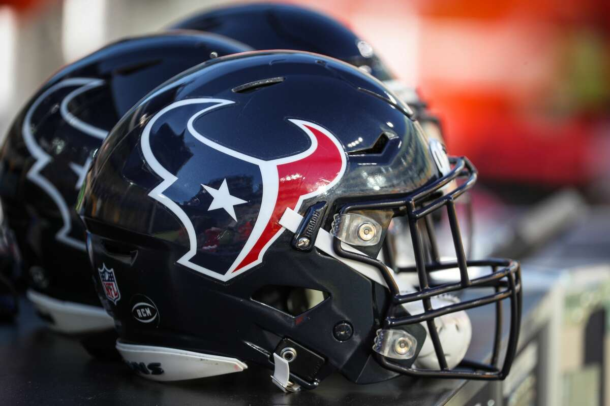 Houston Texans helmets on the bench before an NFL pre-season football game Saturday, Aug. 14, 2021, in Green Bay, Wis.