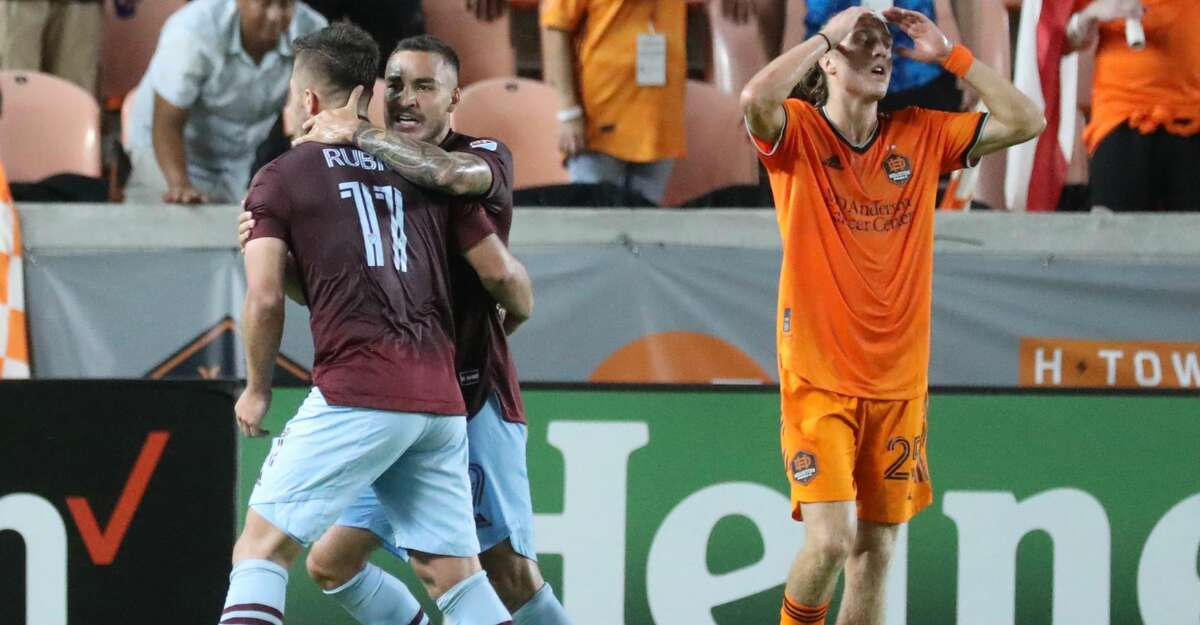 Colorado Rapids forward Diego Rubio (11) hugs Andre Shinyashiki (9) after his goal during the second half of an MLS soccer game at BBVA Stadium, Saturday, August 14, 2021, in Houston.