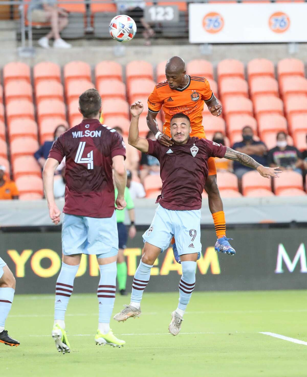Colorado Rapids forward Andre Shinyashiki (9) and Houston Dynamo midfielder Fafa Picault (10) go up for th ball during the first half of an MLS soccer game at BBVA Stadium, Saturday, August 14, 2021, in Houston.
