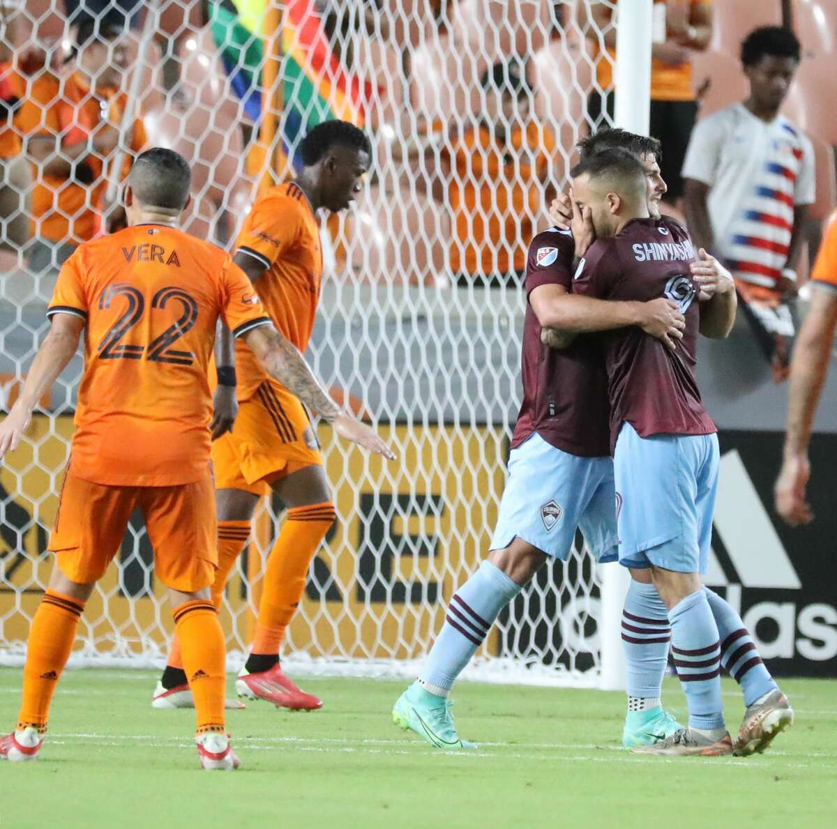 Colorado Rapids forward Andre Shinyashiki (9) hugs Diego Rubio (11) after an attempted shot on Houston Dynamo goalkeeper Marko Maric (1) during the second half of an MLS soccer game at BBVA Stadium, Saturday, August 14, 2021, in Houston.