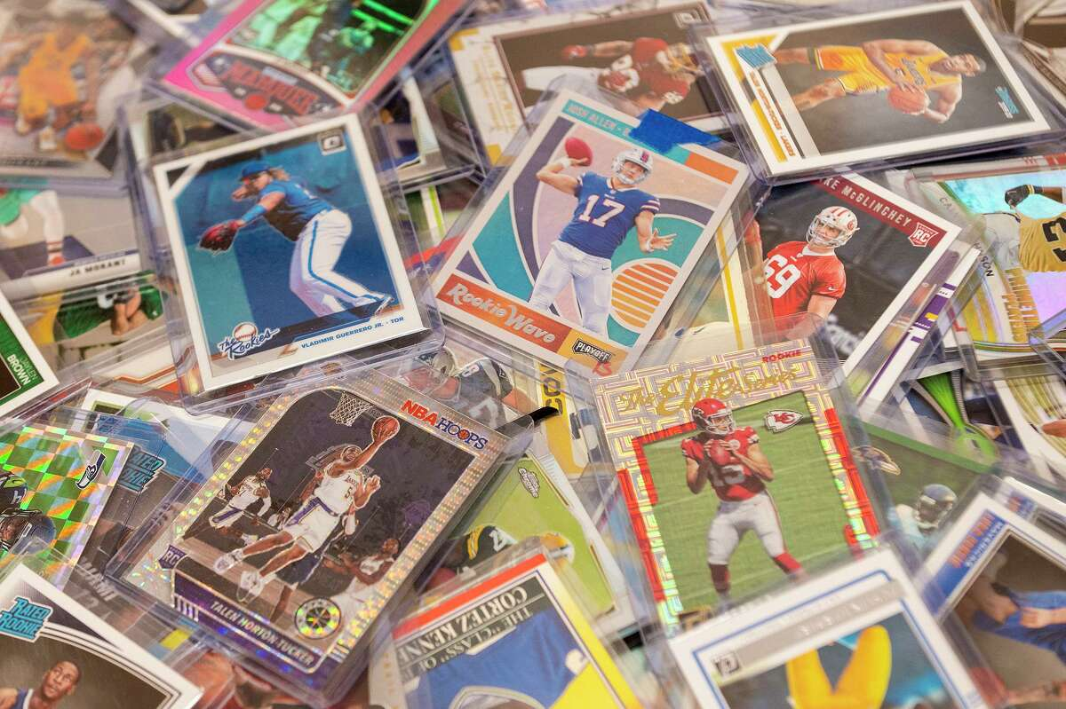 Three Nixon coaches have bonded over collecting sports cards.