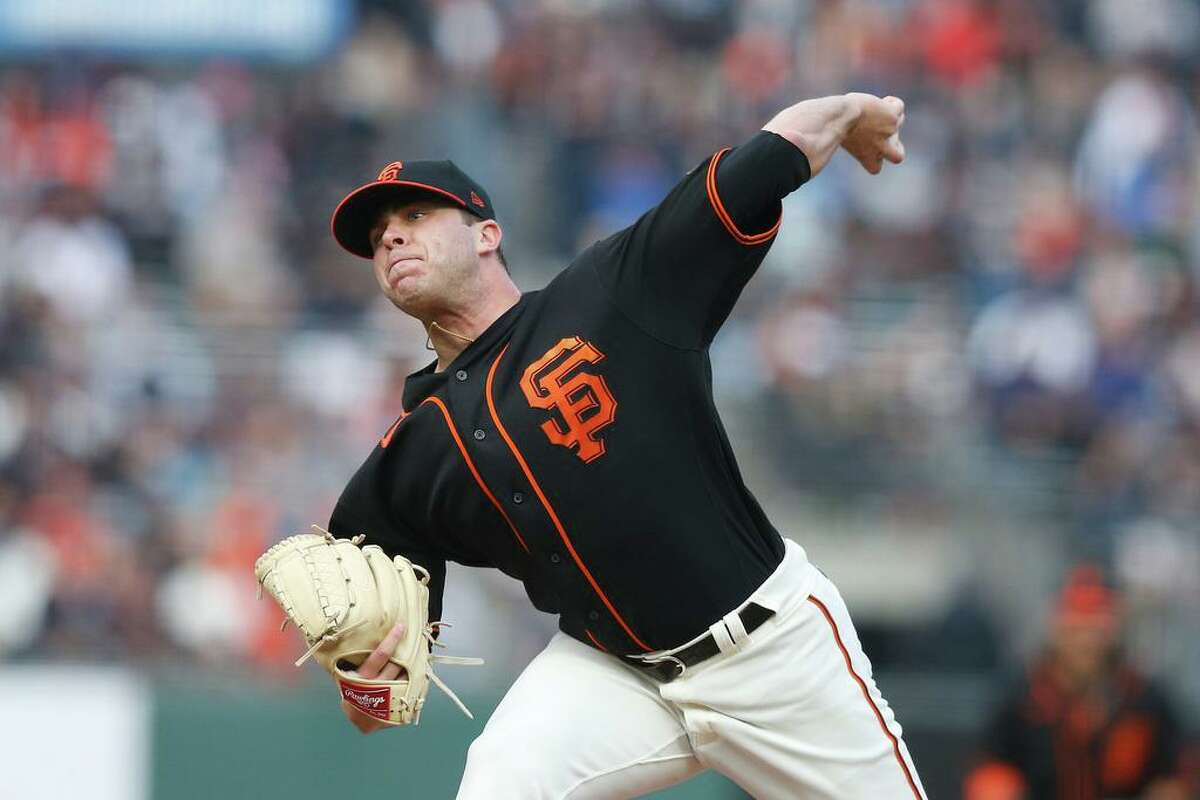 SAN FRANCISCO, CALIFORNIA - AUGUST 14: Sammy Long #73 of the San Francisco Giants pitches in the top of the first inning against the Colorado Rockies at Oracle Park on August 14, 2021 in San Francisco, California. (Photo by Lachlan Cunningham/Getty Images)