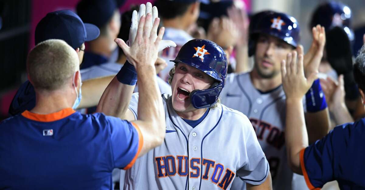Houston Astros' Jake Meyers is congratulated for his grand slam in the sixth inning while playing against the Los Angeles Angels during a baseball game Saturday, Aug 14, 2021, in Anaheim, Calif. (AP Photo/John McCoy)