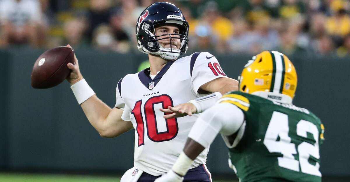 Houston Texans quarterback Davis Mills (10) throws a pass over Green Bay Packers inside linebacker Oren Burks (42) during the second quarter of an NFL pre-season football game Saturday, Aug. 14, 2021, in Green Bay, Wis.
