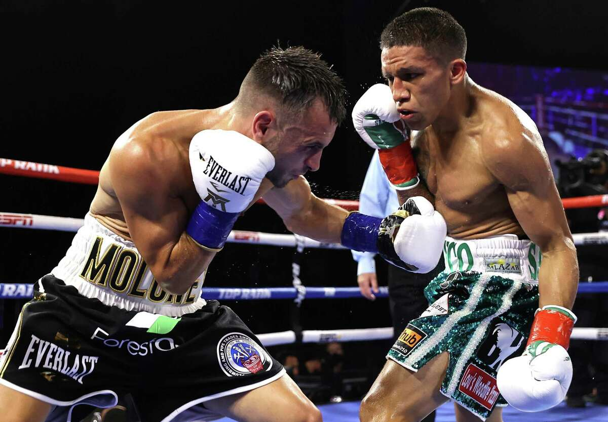 Australia's Andrew Moloney, left, punches San Antonio's Joshua Franco during Saturday's WBA super flyweight championship bout. Franco won by unanimous decision.