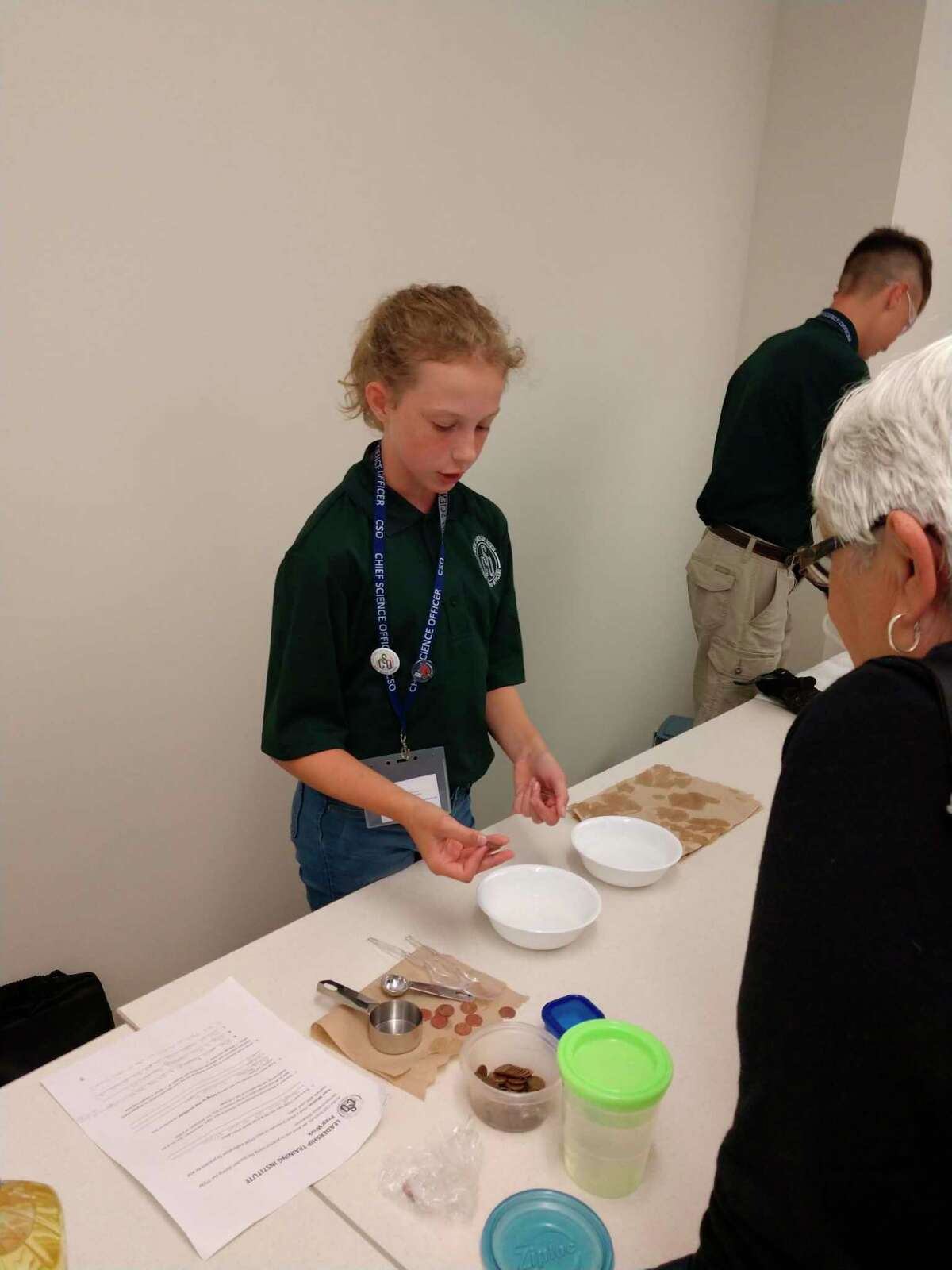 Norah Lacher is seen performing a scientific demonstration. (Photo provided)