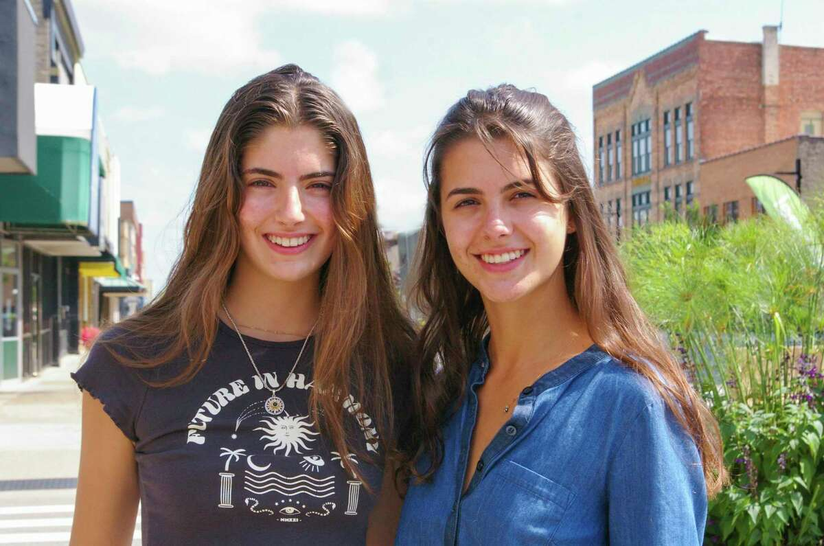 Gabriela Donoso, left, and her sister Carolina Donoso, right, enjoyed their international upbringing. With their sister Helena, and their parents, they lived in countries including Argentina, Brazil, Italy, Japan and Switzerland before moving to Midland in 2012. (Photo by Niky House/For the Daily News)