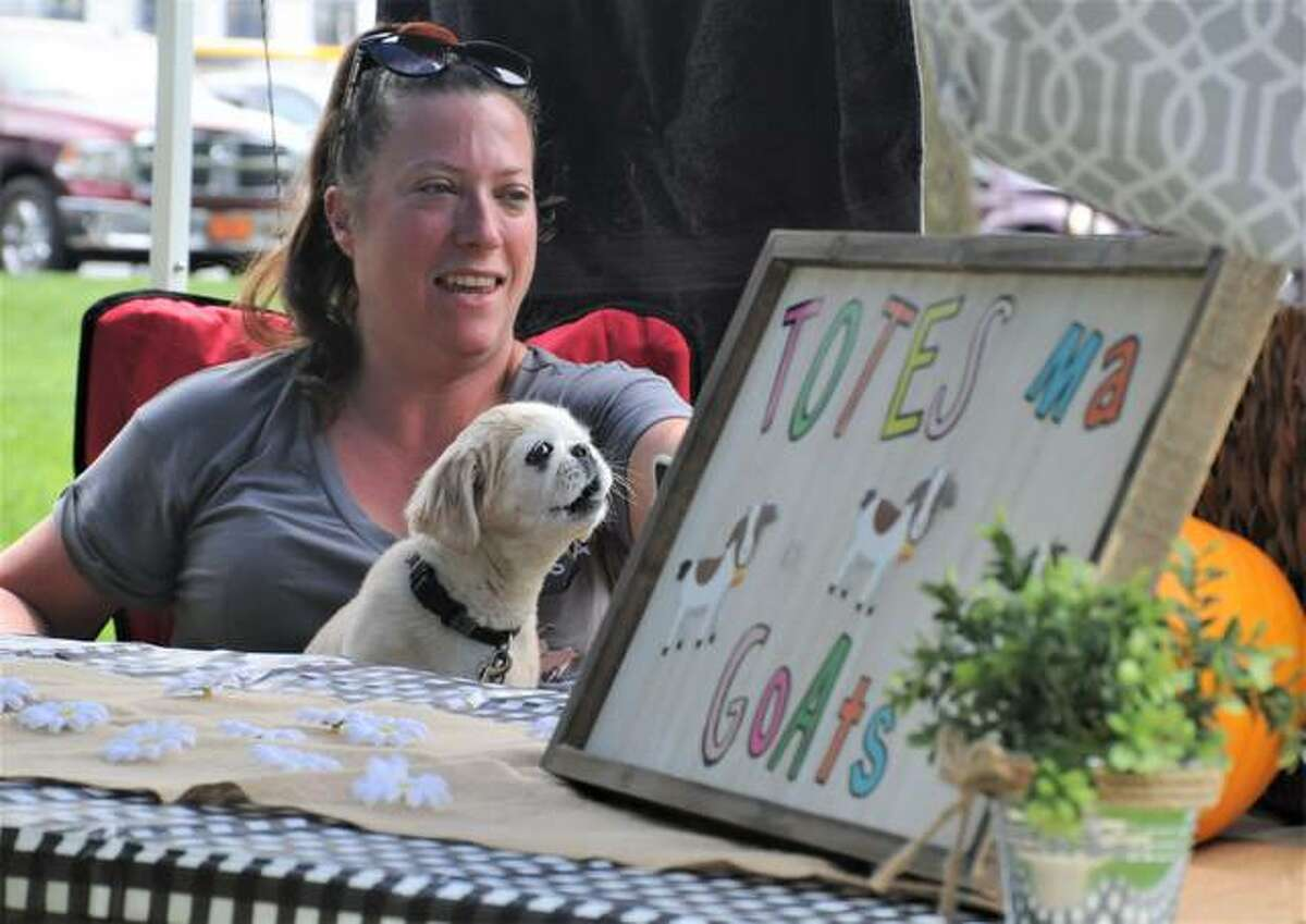 Sara Tex and Niemi operate a booth at Saturday's Pawty in the Park.