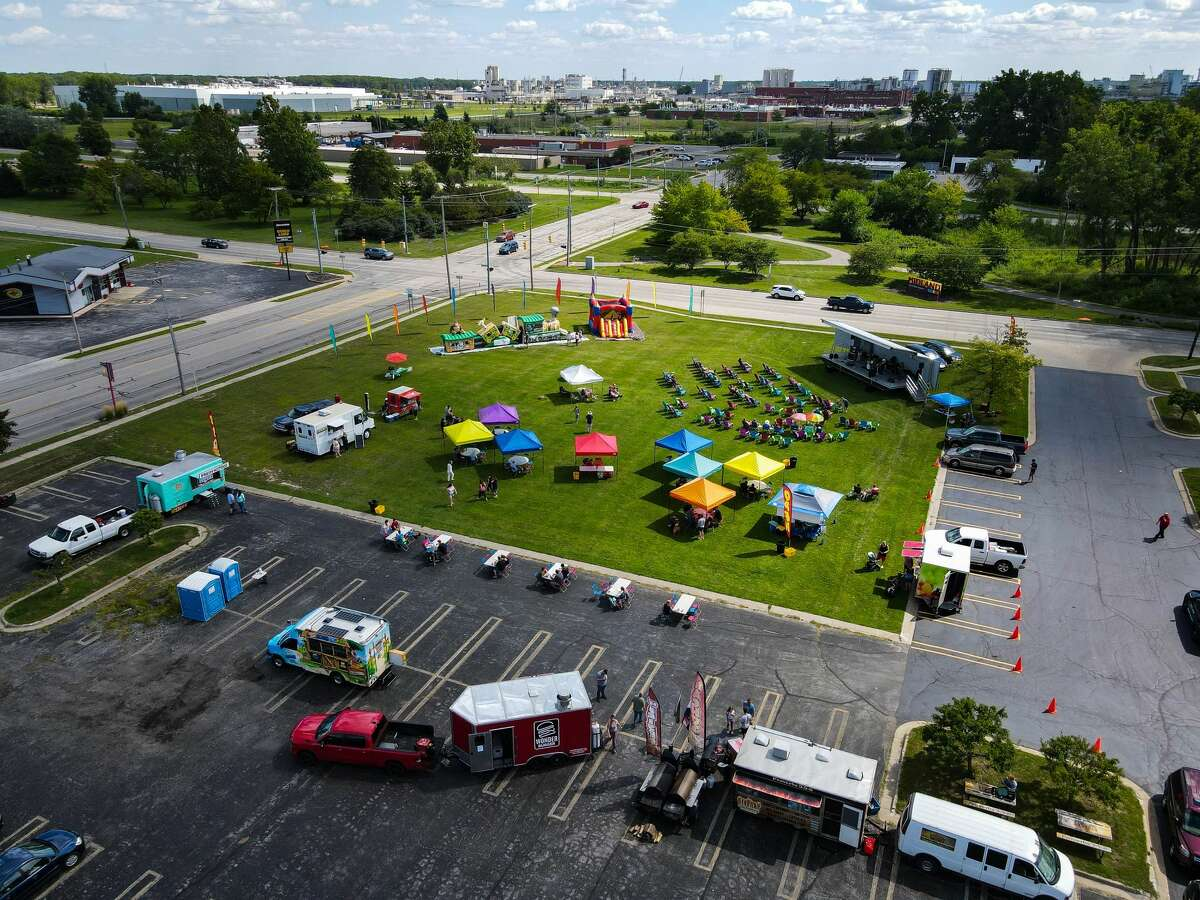 An aerial shot of the festivities during a Food Truck Festival Saturday, August 14, 2021 at the Midland Towne Center. (Drew Travis/for the Daily News)