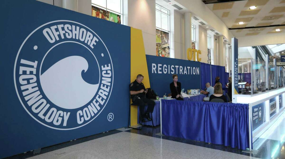 Registration desk prep as exhibitors prepare for Monday's opening of exhibitors preparing for OTC 2021 at NRG Center, Saturday, August 14, 2021, in Houston.