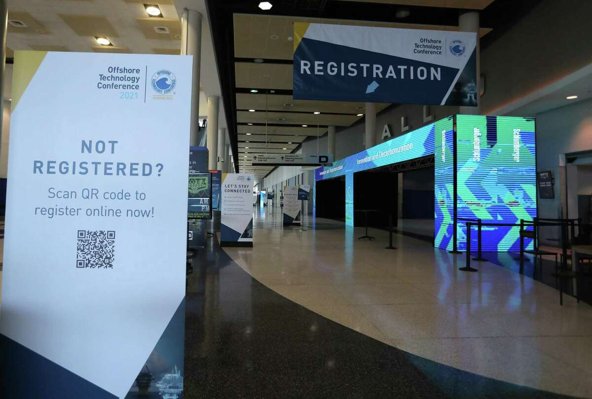 Hallway signage as exhibitors prepared for Monday's opening of exhibitors preparing for OTC 2021 at NRG Center, Saturday, August 14, 2021, in Houston.