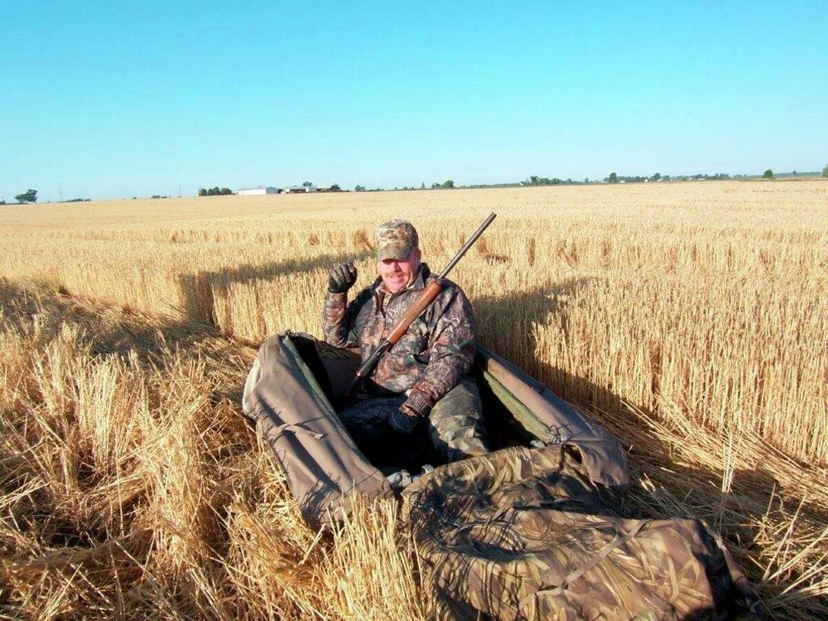 Randy Severance of Decker taking a break in his layout blind during a September Early Goose Season in a Thumb wheat-stubble field.(Tom Lounsbury/Hearst Michigan)