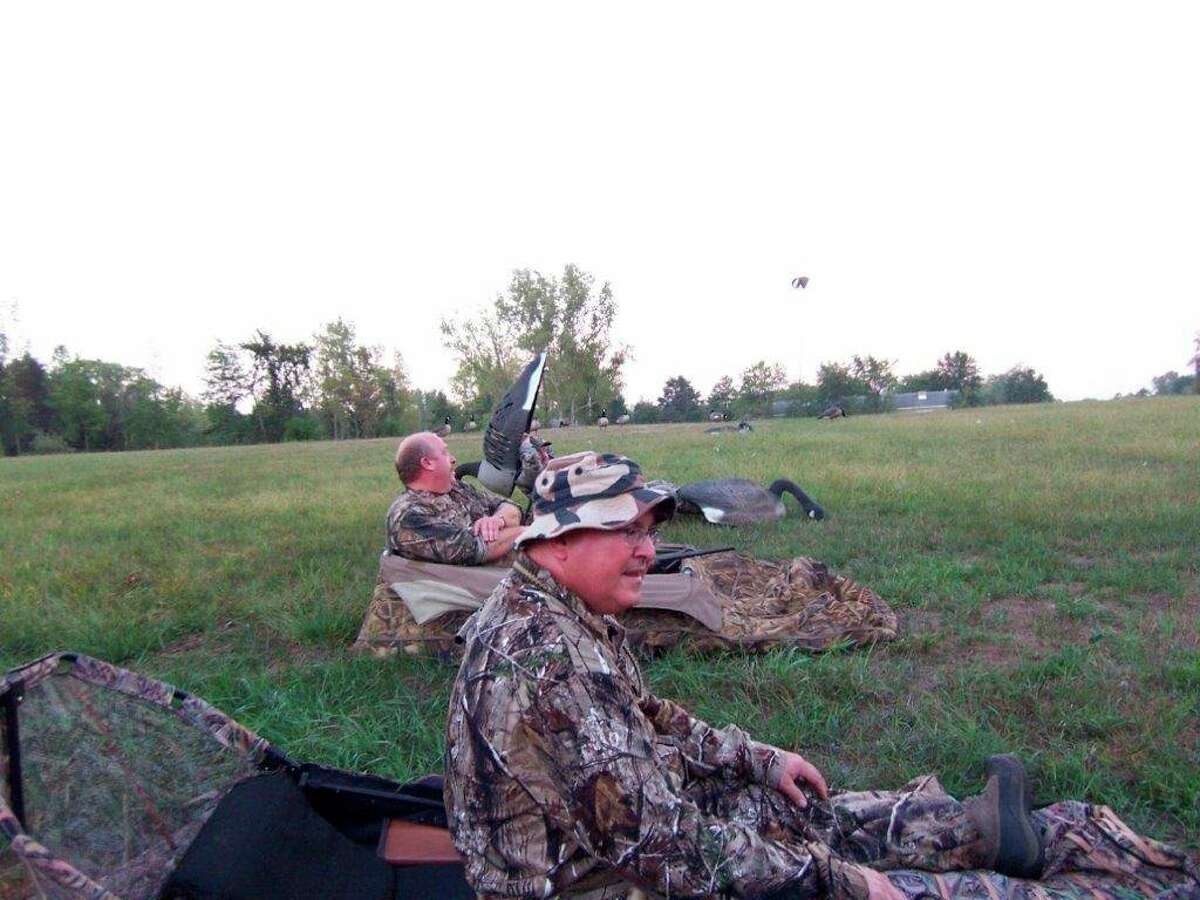 September goose hunters getting ready in their layout blinds to start calling geese into their decoy spread, near a Thumb campground being pestered by Canada geese.