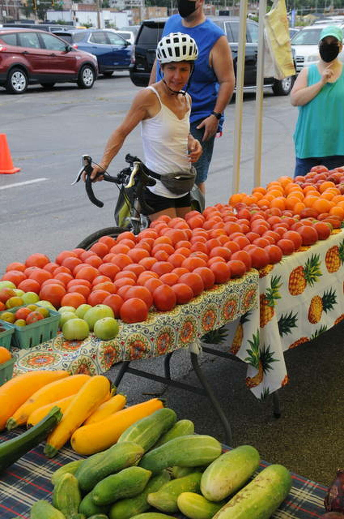 Cara Spencer of St. Louis looks at the wide variety of fresh produce in downtown Alton on Saturday.