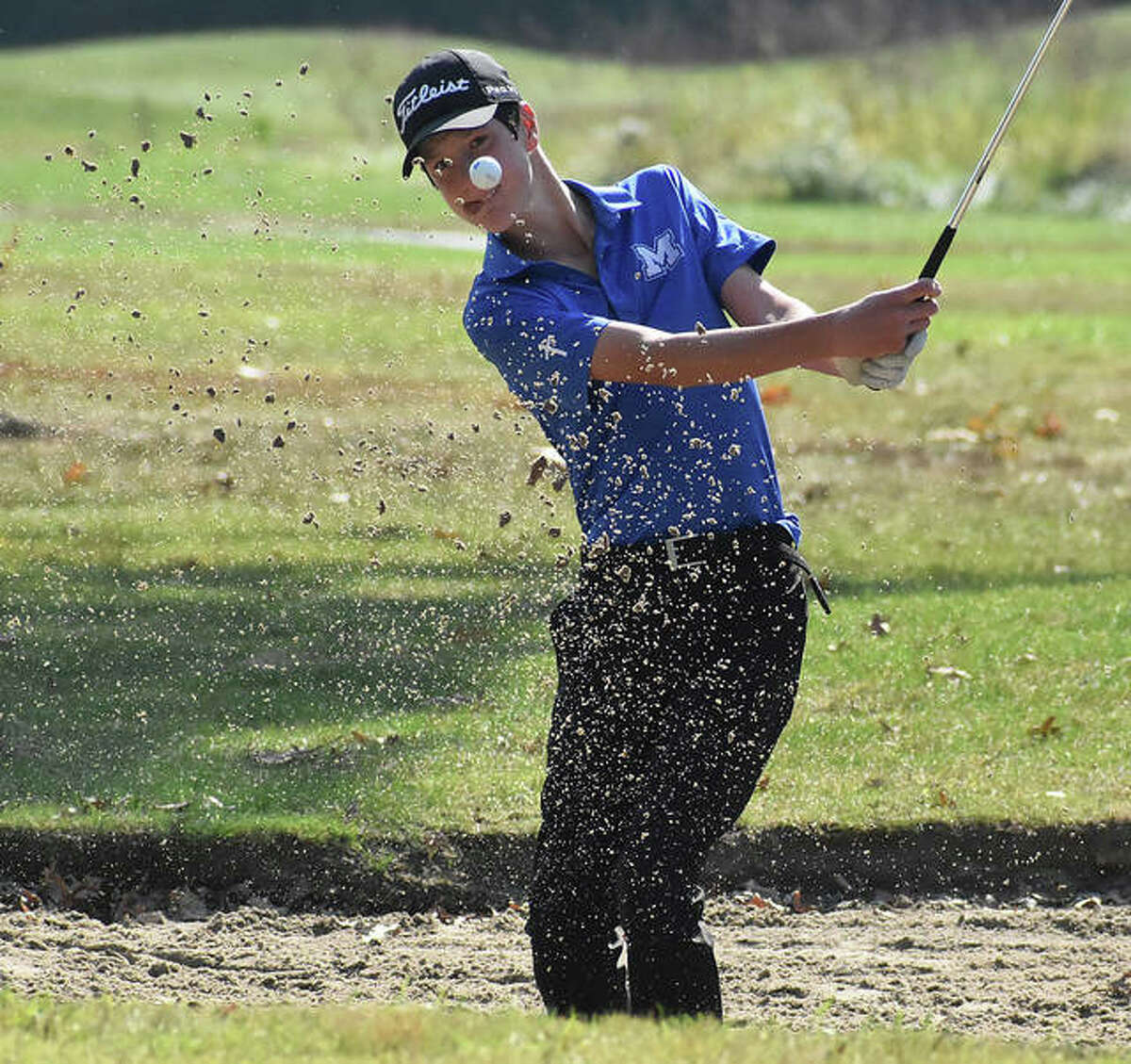 Marquette Catholic's Aidan O'Keefe chips out of the sand during a Class 1A regional last season at Timber Lakes golf course in Staunton. O'Keefe, now a junior, and the Explorers be part of the 16-team field opening their 2021 boys golf season Monday in EA-WR's Hickory Stick Invitational at Belk Park in Wood River. Mascoutah will be back to defend the championship it won in 2020, along with the return of Hillsboro following a year's absence because of covid travel restrictions last season. The Hiltoppers won three successive Hickory Stick titles from 2017-19. The rest of the field includes Civic Memorial, Father McGivney, Jersey, Metro-East Lutheran, Mount Olive, Roxana, Southwestern, Triad, Vandalia, Dupo, Granite City, Litchfield and the host Oilers. The tourney begins with a shotgun start at 8:30 a.m.