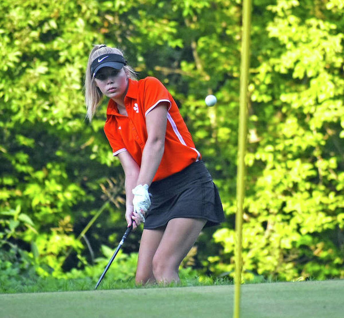 Edwardsville's Sophia Rankin hits a chip shot onto the green on Hole No. 5 at Woodlands Golf Club on Saturday during the Alton Kick-Off Scramble/Shamble.
