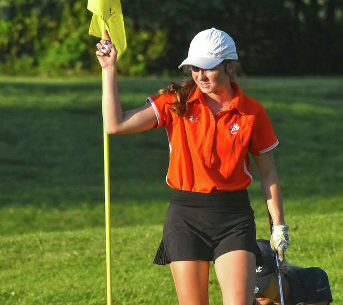 Edwardsville's Lucy Sheeley smiles after sinking a putt on Hole No. 7 at Woodlands Golf Club on Saturday during the Alton Kick-Off Scramble/Shamble.
