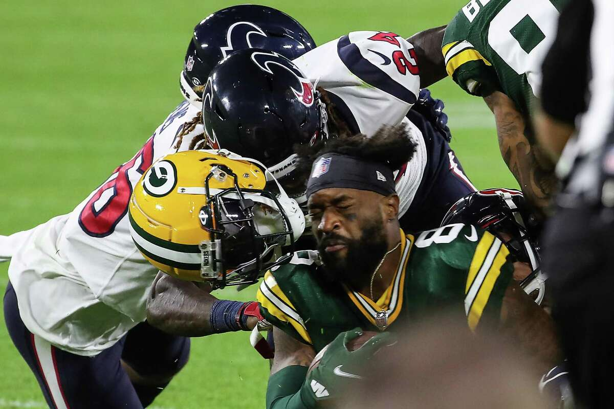 The Texans secondary got in its share of hits as well against the Packers in Saturday's preseason opener. Tremon Smith knocks the helmet off Green Bay wide receiver Amari Rodgers.
