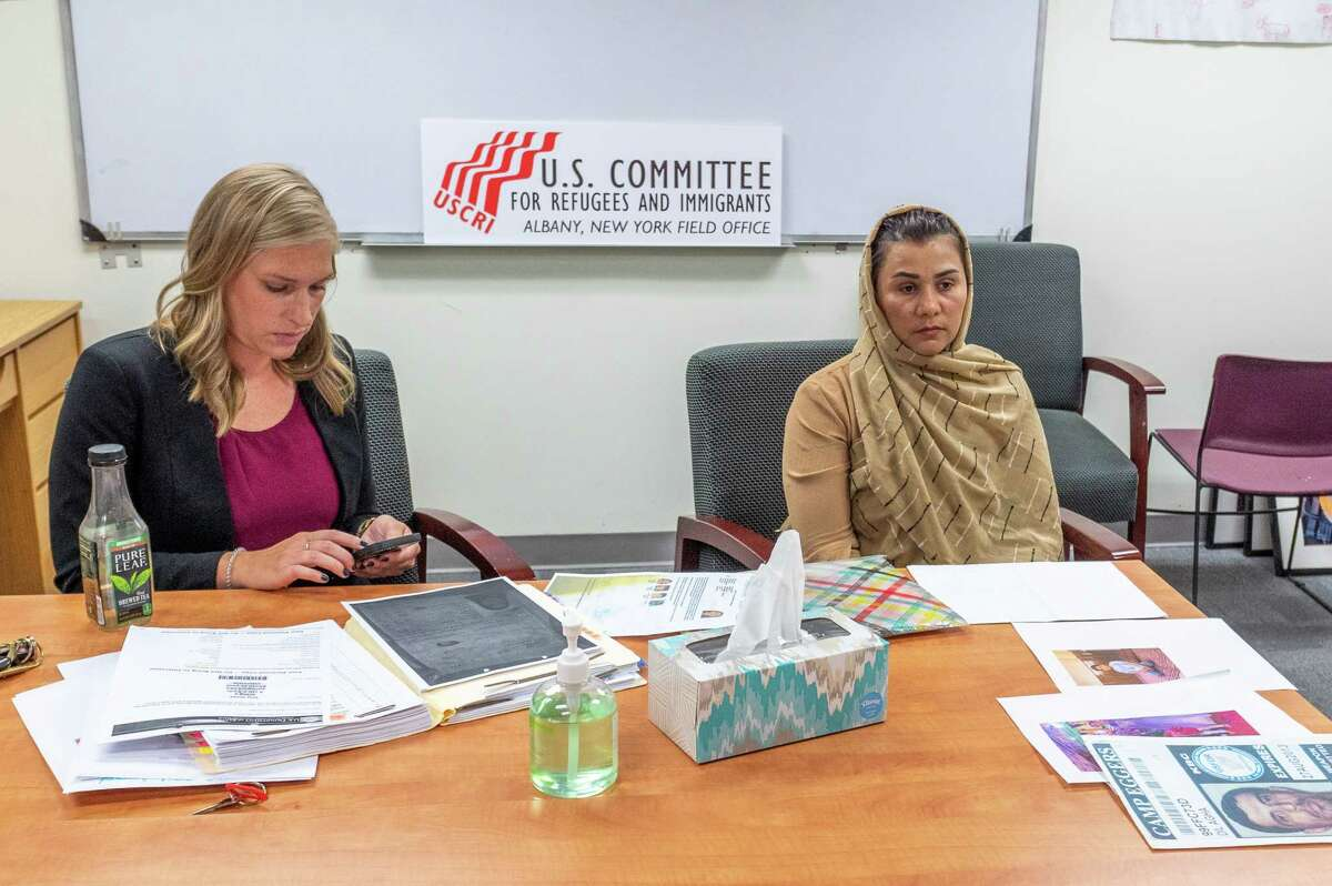 Sara E. Lowry, a staff attorney for the U.S. Committee for Refugees and Immigrants, and Suneeta, talk to media on Sunday, Aug. 15, 2021 about efforts to get Suneeta's four children out of Afghanistan (Jim Franco/Special to the Times Union.)
