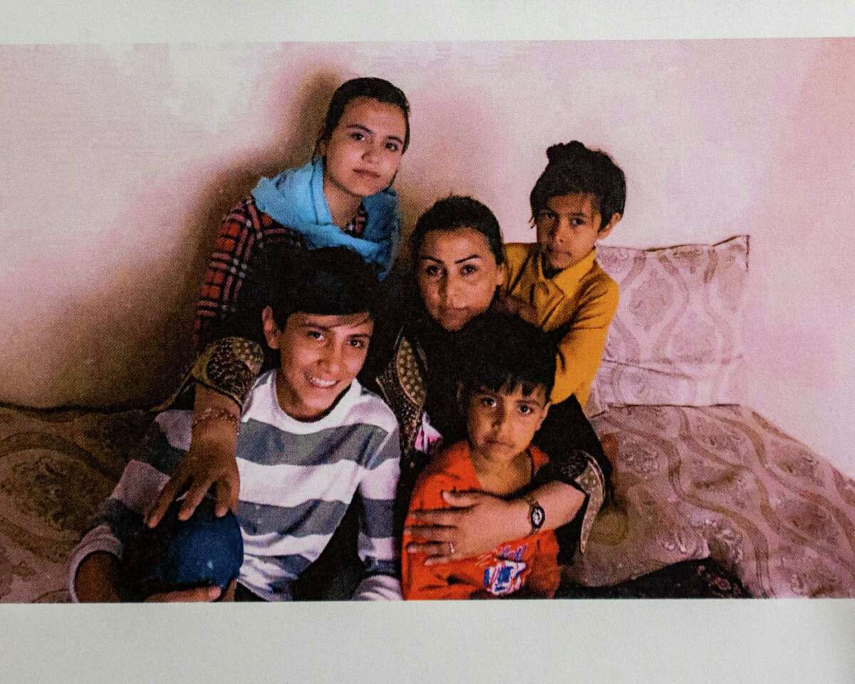 A photo of Suneeta and her four children. She talked to the media at the U.S. Committee for Refugees and Immigrants in Albany, NY, on Sunday, Aug. 15, 2021 about efforts to get them out of Afghanistan (Jim Franco/Special to the Times Union)