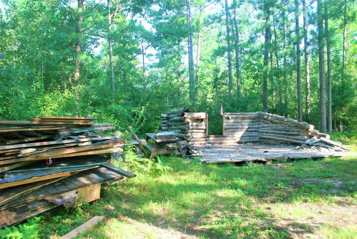 The cabin at the White Pine Valley Recreation Area is being demolished due to concerns over the safety of the structure. Scout leaders with Troop 114 have worked to tear down and remove the structure. (Pioneer photo/Cathie Crew)