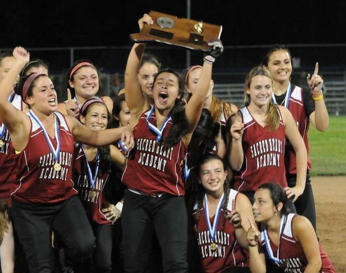 The 2011 Sacred Heart Academy softball team celebrates winning the CIAC Class M softball title as the 23rd seed. Maegan (Rodriguez) Onofrio, recently named new SHA softball head coach, stands in the center holding the championship plaque.