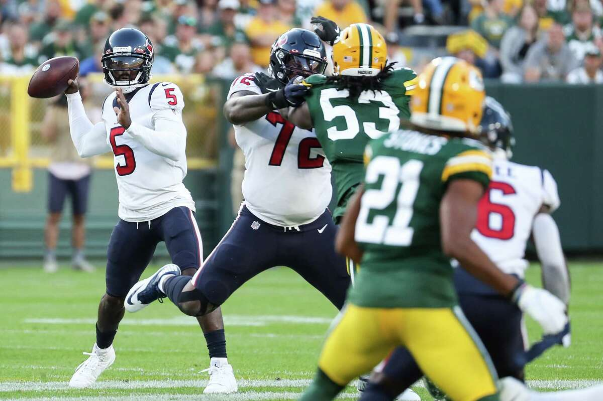 Houston Texans quarterback Tyrod Taylor (5) throws a pass against the Green Bay Packers during the first quarter of an NFL pre-season football game Saturday, Aug. 14, 2021, in Green Bay, Wis.