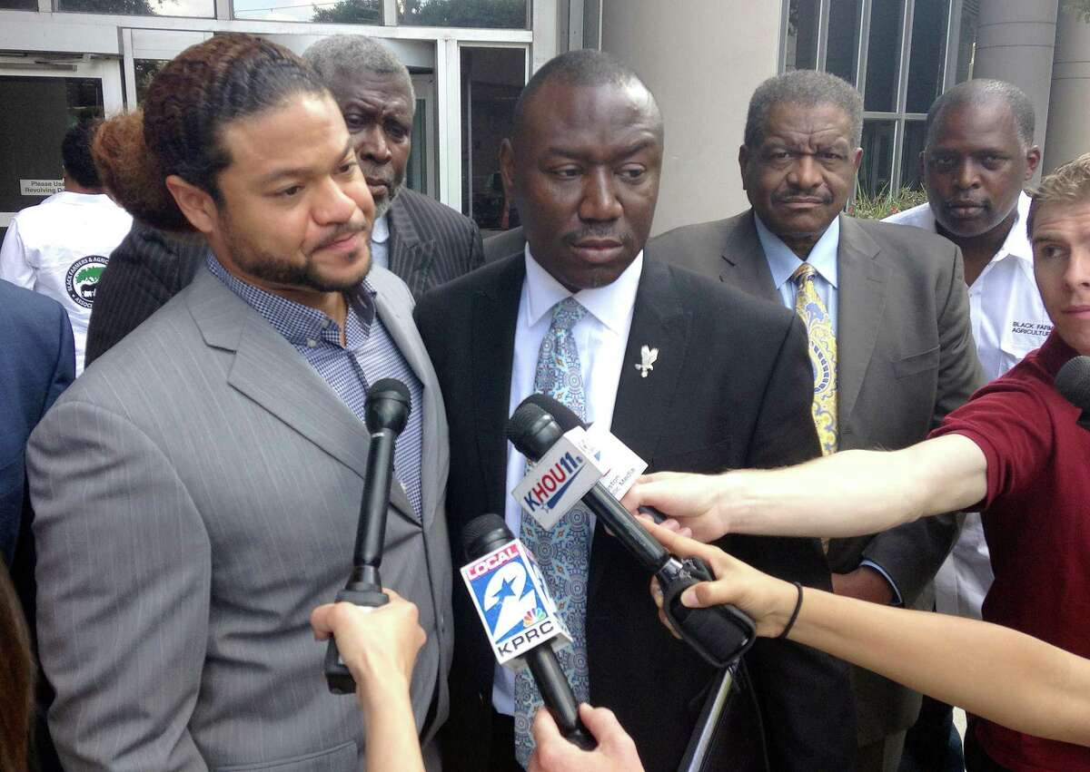 Robbie Tolan (left); one of his lawyers, Benjamin Crump, and Tolan's other supporters outside the federal courthouse in Houston following a hearing for his civil lawsuit against Bellaire Police over a 2008 shooting.