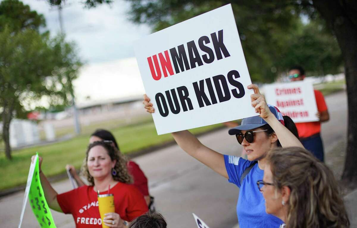 Anti-mask demonstrators outside Houston Independent School District building before it holds a meeting about having a mask mandate in Houston on Thursday, Aug. 12, 2021.